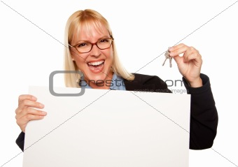 Attractive Blonde Holding Keys and Blank White Sign Isolated on a White Background.