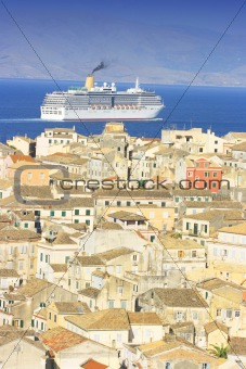 Old city of Corfu in Greece with cruiser boat passing