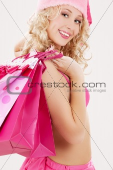 santa helper with pink shopping bags