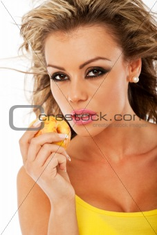 beautiful woman holding a peach