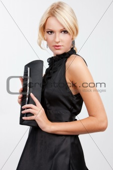 Blond girl with a purse
