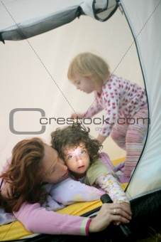 Camping tent vacation with mother and daughters