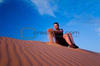 Woman admiring Coral Pink Sand Dunes State Park in Utah