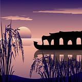 silhouette of a boathouse,backwaters and sunrise background