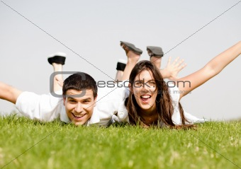 cute young Couple lie down on grass
