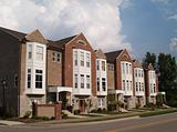 Row of Brick Condos With Bay Windows