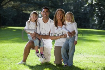 Happy Family Having Fun In A Park