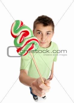 Boy showing lollipop candy