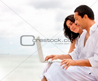Couple outdoors with laptop