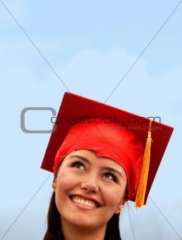 Pensive graduation woman