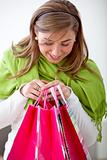 Woman peeking at shopping bags
