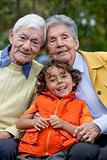 Kid with his grandparents