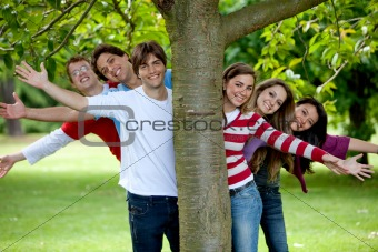 Friends behind a tree