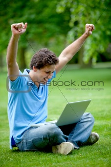 Excited man with computer