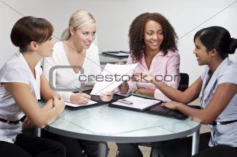 Four Modern Businesswomen In Office Meeting