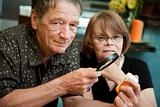 Senior man and woman examining medications