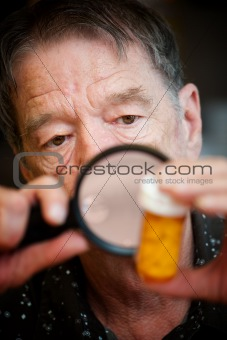 Senior man examining medications