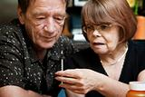 Man and woman with small hypodermic needle 