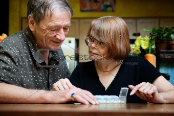 Senior couple with daily supplements