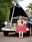 Girl in red with vintage car