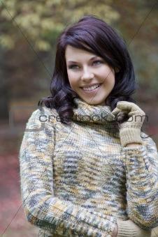 smiling brunette in park