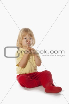 boy with long blond hair holding magnifying glass