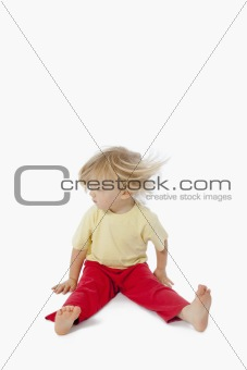 boy with long blond hair shaking his head to make it fly