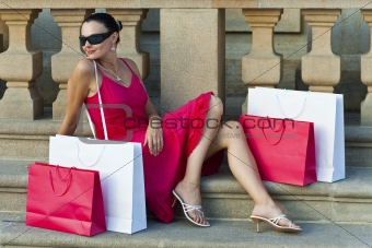 Beautiful Latin Woman In Red Dress With Shopping Bags