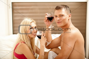 Couple drinking on the bed