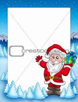 Frame with Santa and Christmas gift