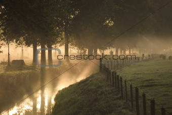 A landscape with fog and a sunrise in the Netherlands