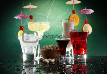 Five happy drinks on teal