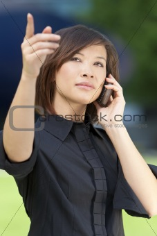 Beautiful Oriental Asian Chinese Woman On Cell Phone and Pointin