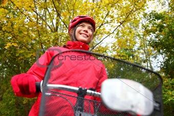 Fall bike woman