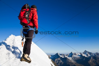 Mountaineer on a snowy ridge