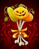 funny bouquet made of halloween pumpkins on bones