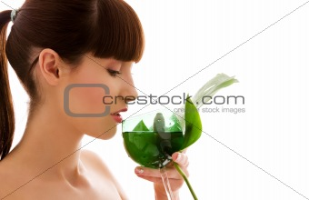 woman with green leaf and glass of water