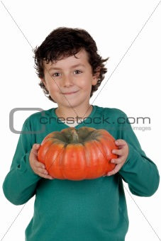 Beautiful little boy with a big pumpkin