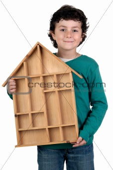 Adorable child with wooden house