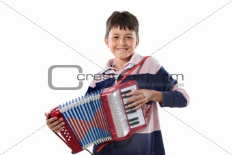 Adorable child playing red accordion