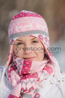 Pretty girl wearing warm hat and scarf