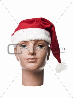 Santa claus hat on a doll