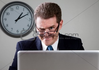Crazy Businessman on Laptop Computer
