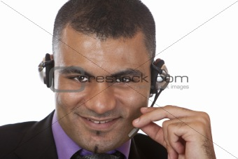 Portrait of Young male call center agent with headset