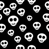 Seamless pattern with white skulls on black background