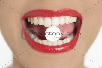 Beauty woman mouth with medicine pill
