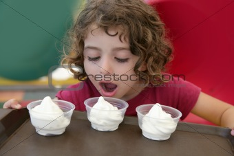 Adorable little girl holding three ice cream