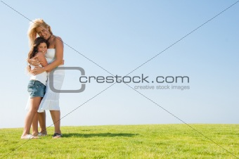 Affectionate mother embracing