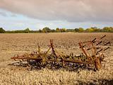 harrows in a plowed field