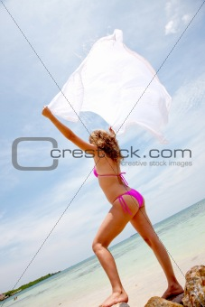 Bikini woman feeling the wind